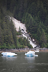 waterfall from melting snow and small icebergs along the Tracy Arms fjord along the southeastern Alaska coast,