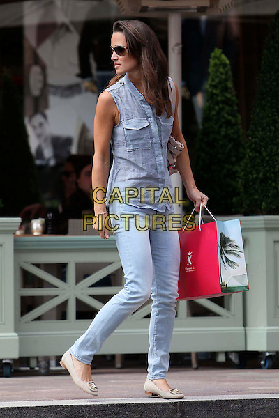 PIPPA MIDDLETON ( PHILLIPA 'PIP' MIDDLETON).Spotted at Harrods, London, England, UK, May 19th 011..full length sleeveless blue shirt jeans denim stone wash beige bag flats flat shoes sunglasses shades shopping bag looking over shoulder walking .CAP/HIL.©John Hillcoat/Capital Pictures .