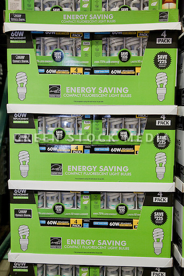 Close up of green packages of Feit Electric brand Energy Star rated compact fluorescent light bulbs (CFLs). The packaging promotes energy conservation, saving money, and long product life.
