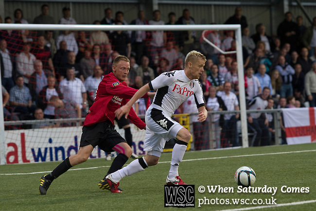 Crusaders 1 Fulham 3, 16/07/2011. Seaview Park, Europa League 2nd qualifying round first leg. Fulham's Irish winger Damien Duff (right) in action during the second half against Northern Irish club Crusaders in a UEFA Europa League 2nd qualifying round, first leg match at Seaview, Belfast. The visitors from England won by 3 goals to 1 before a crowd of 3011. Photo by Colin McPherson.