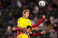 Columbus Crew defender Chad Marshall (14) heads a ball past Chivas USA forward Alejandro Moreno (15). Chivas USA and Columbus Crew played to a 0-0 tie at Home Depot Center stadium in Carson, California on  April  9, 2011....