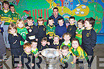 Pre-school children in Gaelscoil Aogain Castleisland were delighted when Ger Reidy posed with the Sam Maguire on Wednesday