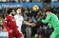 Federico Fernandez of Swansea City looks on as Goalkeeper Lukasz Fabianski of Swansea City  heads clear during the Premier League match between Swansea City and Liverpool at the Liberty Stadium, Swansea, Wales on 22 January 2018. Photo by Mark Hawkins / PRiME Media Images.