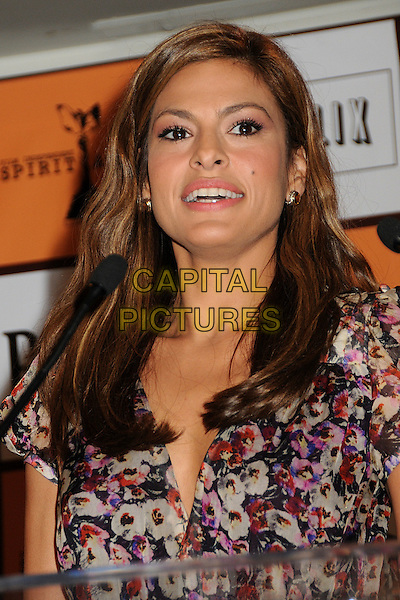 EVA MENDES .2011 Film Independent Spirit Award Nominations held at The London Hotel, West Hollywood, California, USA, .30th November 2010..portrait headshot pink floral print mouth open purple black microphone podium  indie.CAP/ADM/BP.©Byron Purvis/AdMedia/Capital Pictures.