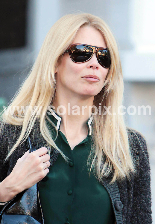 **ALL ROUND PICTURES FROM SOLARPIX.COM**                                             **WORLDWIDE SYNDICATION RIGHTS**                                                                                  Caption: Claudia Schiffer drops her children off at school in London. 10 November 2010                                                                        This pic: Claudia Schiffer drops her children off at school                                                                                             JOB REF: 12456 LNJ       DATE: 10_11_2010                                                           **MUST CREDIT SOLARPIX.COM OR DOUBLE FEE WILL BE CHARGED**                                                                      **MUST AGREE FEE BEFORE ONLINE USAGE**                               **CALL US ON: +34 952 811 768 or LOW RATE FROM UK 0844 617 7637**