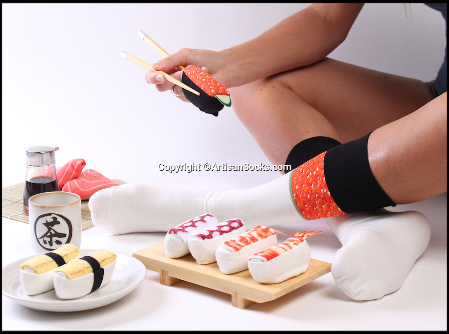 BNPS.co.uk (01202 558833)<br /> Pic: ArtisanSocks/BNPS<br /> <br /> ***Must Use Full Byline***<br /> <br /> Soft Sushi Shuffle...<br /> <br /> Now, should you wish to, you can make your sock draw look like a sushi bar. <br /> <br /> These morsels of mouthwatering sushi might look tantalising but you wouldn't want to eat them - because they're actually rolled up socks.<br /> <br /> The super-realistic items of clothing are the latest bizarre trend sweeping the fashion world and have been an instant hit with shoppers.<br /> <br /> Unrolled they look like any other sock but rolled up they form seven different varieties of the raw fish snack, transforming your underwear drawer into a smorgasbord of sushi.<br /> <br /> The life-like 'flavours' include egg (tamago), salmon roe (ikura), shrimp (ebi), octopus (tako), tuna (maguro ), salmon (sa-mon) and trout (masuzishi).<br /> <br /> Sushi socks cost $6 a pair - around £3.70 - and can be bought from artisansocks.com.