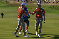 Henrik Stenson (Team Europe) congratulates Justin Rose (Team Europe) for sinking his putt to win the hole on 10 during Saturday's foursomes of the 2018 Ryder Cup, Le Golf National, Guyancourt, France. 9/29/2018.<br /> Picture: Golffile | Ken Murray<br /> <br /> <br /> All photo usage must carry mandatory copyright credit (© Golffile | Ken Murray)