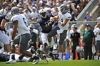 07 September 2013:  Penn State DE Deion Barnes (18) pressures Eastern Michigan QB Tyler Benz (12).  The Penn State Nittany Lions defeated the Eastern Michigan Eagles 45-7 at Beaver Stadium in State College, PA.