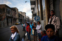 Cubans wait at a bus stop in central Havana, Cuba on 28 October 2008.