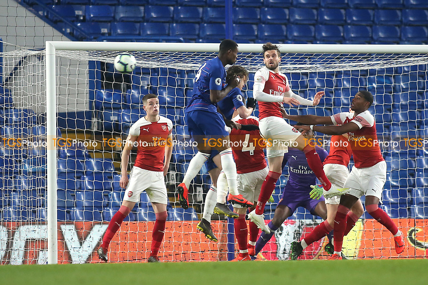 Carl Jenkinson of Arsenal heads the ball out of defence during Chelsea Under-23 vs Arsenal Under-23, Premier League 2 Football at Stamford Bridge on 15th April 2019