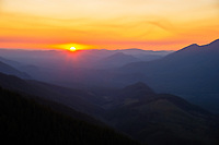 Sunset over Sol Duc Valley from Merrill Ring property.  Olympic Peninsula, Washington.  Sept.   Note: The Sol Duc River runs down the far right valley.  Also, the sun is setting into the Pacific Ocean--can see just a sliver of ocean to the west from upper Merrill & Ring property.