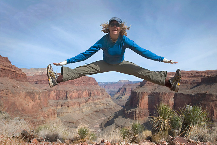 Kelly jumps for joy upon reaching the crux of a very difficult route in the Grand Canyon National Park, AZ