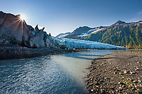 Glacial run-off water flows in a creek into Harriman Fjord, near the terminus of the tidewater face of Harriman glacier, Chugach mountains, Chugach National Forest, Prince William Sound, southcentral, Alaska.