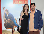 Adam Sandler and Jackie Sandler arriving at the premiere of Blended held at TCL Chinese Theatre Los Angeles Ca. May 21, 2014.