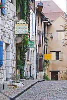 A cobble stone street in the old town with charming character-full old stone houses, sign saying Le Logis Plantagenet Bed and Breakfast on Place de la Myrpe, facing Place du Docteur Cayla Square Bergerac Dordogne France