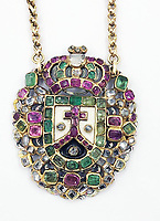 BNPS.co.uk (01202 558833)<br /> Pic: KidsonTrigg/BNPS<br /> <br /> £6000 - C17th Iberian gold gem set  of ruby,diamond & emerald shield shaped jewelled pendant ornament with enamelled back on integral rope twist necklace.<br /> <br /> Frozen Assets - Over a £100,000 of Renaissance era jewellry found under a frozen joint of lamb in a run down chalet bungalow is coming up for auction.<br /> <br /> Amazed auctioneers found the hidden gems in the ramshakle hoarders freezer near Uffington in Wiltshire - where the canny late owner had gone to great lengths to protect her precious haul.<br /> <br /> However, the hidden stash wasn't the result of a bank heist but belonged to an eccentric collector who amassed the items in the 1960s - and kept the receipts to prove it.<br /> <br /> She passed away recently and her family brought in experts to hunt out relics they knew their relative had hidden away over the years.