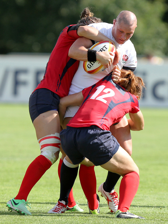 Heather Fisher tackled. England v Spain Pool A match at WRWC 2014 at Centre National de Rugby, Marcoussis, France, on 5th August 2014