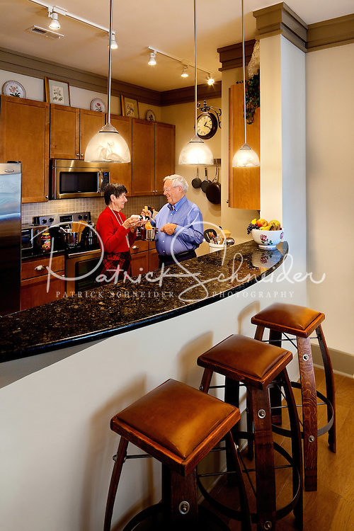 A couple holds prepares dinner in their home Asheville NC's Biltmore Park Town Square, a planned community in the Blue Ridge Mountains of residential living, office spaces and shopping.