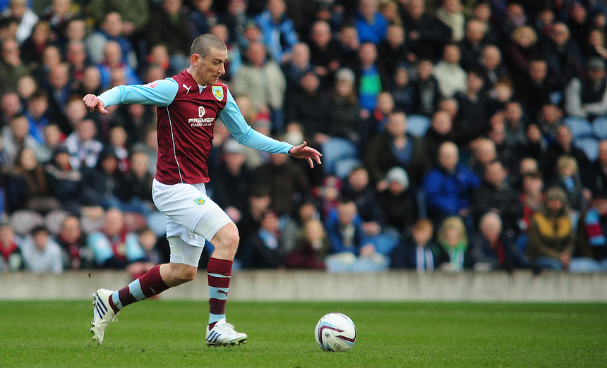 Burnley's David Jones <br /> <br /> Photo by Chris Vaughan/CameraSport<br /> <br /> Football - The Football League Sky Bet Championship - Burnley v Derby County - Saturday 1st March 2014 - Turf Moor - Burnley<br /> <br /> &copy; CameraSport - 43 Linden Ave. Countesthorpe. Leicester. England. LE8 5PG - Tel: +44 (0) 116 277 4147 - admin@camerasport.com - www.camerasport.com
