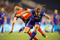 Orlando, Florida - Sunday, May 14, 2016: Orlando Pride defender Laura Alleway (5) and Western New York Flash midfielder Samantha Mewis (5) collide during a National Women's Soccer League match between Orlando Pride and New York Flash at Camping World Stadium.