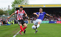 Lincoln City's James Wilson crosses the ball despite the attentions of Exeter City's Dean Moxey<br /> <br /> Photographer Chris Vaughan/CameraSport<br /> <br /> The EFL Sky Bet League Two Play Off First Leg - Lincoln City v Exeter City - Saturday 12th May 2018 - Sincil Bank - Lincoln<br /> <br /> World Copyright &copy; 2018 CameraSport. All rights reserved. 43 Linden Ave. Countesthorpe. Leicester. England. LE8 5PG - Tel: +44 (0) 116 277 4147 - admin@camerasport.com - www.camerasport.com