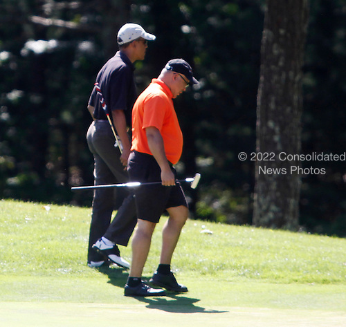 United States President Barack Obama walks to the second hole of the Farm Neck Golf Club with Eric Whitaker in Oak Bluffs, Massachusetts while vacationing on Martha's Vineyard on August 23, 2011.  .Credit: Matthew Healey / Pool via CNP