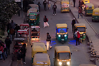 Rickshaws, pedestrians, motorcycles, bicycles, and cars, are seen during the evening commute near HUDA City Centre in Gurugram, Haryana, on Mon., December 10, 2018.