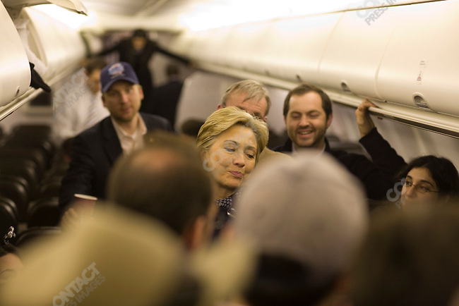 "Senator Hillary Clinton (D-NY), potential Democratic presidential candidate, chats with the press on her charter plane before leaving Minneapolis for a campaign swing through Connecticut, Massachusetts and New York, in hopes of gaining ""Super Tuesday"" votes. Minneapolis, Minnesota, February 3, 2008."