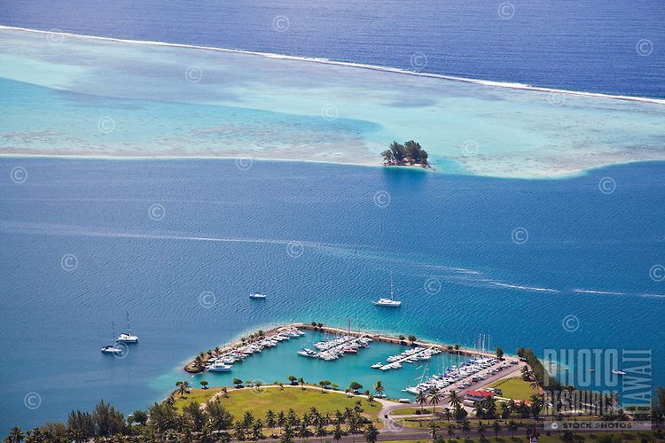 View of harbor, pass, and surrounding reefs from Raiatea island