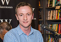 Myles McCionnaith, marketing manager, Merrion Press, Irish Academic Press, at official launch of Crossing the Line by Martin Dillon, Belfast-born author and journalist, at Waterstones, Fountain Street, Belfast, N Ireland, 21st September 2017. 201709214589<br /><br />Copyright Image from Victor Patterson, 54 Dorchester Park, <br />Belfast, UK, BT9 6RJ<br /><br />t1: +44 28 9066 1296 (from Rep of Ireland 048 9066 1296)<br />t2: +44 28 9002 2446 (from Rep of Ireland 048 9002 2446)<br />m: +44 7802 353836<br /><br />victorpatterson@me.com<br />www.victorpatterson.com<br /><br />Please see my Terms and Conditions of Use at VICTORPATTERSON.COM. It is IMPORTANT that you familiarise yourself with them.<br /><br />Images used on the Internet must be visibly watermarked i.e. &copy;VICTORPATTERSON.COM within the body of the image and copyright metadata must not be deleted. Images used on the Internet have a size restriction of 4kbs and are chargeable at the then current NUJ rates.<br /><br />This image is only available for the use of the download recipient i.e. television station, newspaper, magazine, book publisher, etc, and must not be passed on to any third party. It is also downloaded on condition that each and every usage is notified within 7 days to victorpatterson@me.com<br /><br />The right of Victor Patterson to be identified as the author is asserted in accordance with The Copyright Designs And Patents Act (1988).