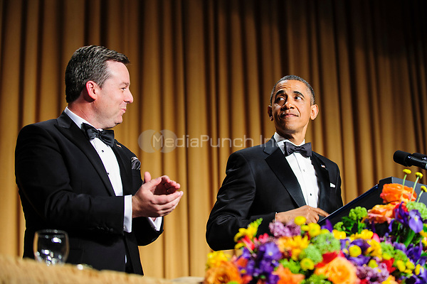 United States President Barack Obama is introduced by White House Correspondents' Association (WHCA) president Ed Henry during the White House Correspondents' Association (WHCA) annual dinner in Washington, District of Columbia, U.S., on Saturday, April 27, 2013.<br /> Credit: Pete Marovich / Pool via CNP /MediaPunch