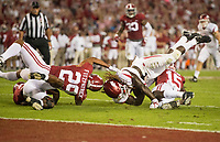 Hawgs Illustrated/BEN GOFF <br /> Tony Brown (2), Minkah Fitzpatrick (29), and Ronnie Harrison (15), Alabama defenders, stop Brandon Martin, Arkansas wide receiver, on a run with second left in the second quarter Saturday, Oct. 14, 2017, at Bryant-Denny Stadium in Tuscaloosa, Ala.