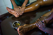 Resident patient get the Abhyanga (full body oil ayurvedic treatment) at the National Research Institute of Panchakarma in Cheruthuruthy in Thissur district of Kerala, India.