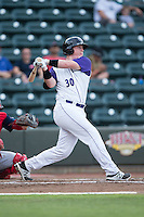 Zack Collins (30) of the Winston-Salem Dash follows through on his swing against the Potomac Nationals at BB&T Ballpark on July 15, 2016 in Winston-Salem, North Carolina.  (Brian Westerholt/Four Seam Images)