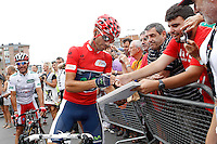 Alejandro Valverde with the fans in presence of Joaquin Purito Rodriguez during the stage of La Vuelta 2012 between Barakaldo and Valdezcaray.August 21,2012. (ALTERPHOTOS/Acero) /NortePhoto.com