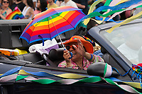 Elderly Woman Holding Rainbow Umbrella, PrideFest, Seattle, WA,, USA.