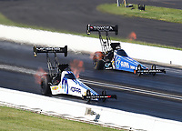 Jul 12, 2020; Clermont, Indiana, USA; NHRA top fuel driver Leah Pruett (near) defeats teammate Tony Schumacher during the E3 Spark Plugs Nationals at Lucas Oil Raceway. This is the first race back for NHRA since the start of the COVID-19 global pandemic. Mandatory Credit: Mark J. Rebilas-USA TODAY Sports