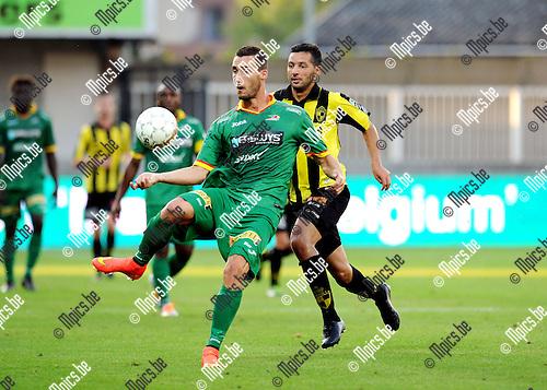 2014-07-26 / Voetbal / seizoen 2014-2015 / SK Lierse - KV Oostende / Baptiste Schmisser (Oostende) met Rachid Bourabia in de rug<br /><br />Foto: mpics.be