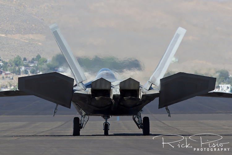 F-22 Raptor checks its control surfaces while taxiing. The F-22 Raptor first entered service in 2005 after 20 years of development. In December of 2011 the 195th, and final, F-22 Raptor rolled off the Lockheed assembly line.