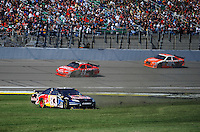 Oct. 4, 2009; Kansas City, KS, USA; NASCAR Sprint Cup Series driver Brian Vickers (83) spins as Tony Stewart (14) and Joey Logano (20) pass during the Price Chopper 400 at Kansas Speedway. Mandatory Credit: Mark J. Rebilas-