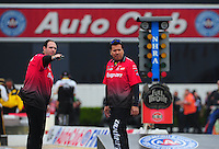 Nov. 10, 2011; Pomona, CA, USA; NHRA funny car driver Cruz Pedregon (right) with a crew member during qualifying at the Auto Club Finals at Auto Club Raceway at Pomona. Mandatory Credit: Mark J. Rebilas-.