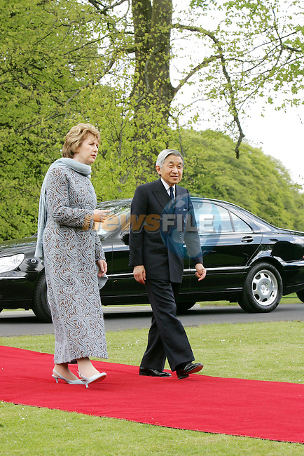 Dublin, Ireland. Japan's Emperor Akihito, right, and Empress Michiko (c) walk with Irish President Mary McAleese, left,and Dr. Martin McAleese (BL) to view a tree planted by the Emperor during an official visit to Ireland in 1985 as Crown Prince, at the Irish President's Residence çras an Uachtar‡in in Dublin Monday May 9. 2005.The Emperor and Empress are on an official three-day tour of Ireland..Photo AFP/NEWSFILE/FRAN CAFFREY..(Photo credit should read AFP Photo FRAN CAFFREY/NEWSFILE)...This Picture has been sent you under the condtions enclosed by:.Newsfile Ltd..the Studio,.Millmount Abbey,.Drogheda,.Co Meath..Ireland..Tel: +353(0)41-9871240.Fax: +353(0)41-9871260.GSM: +353(0)86-2500958.email: pictures@newsfile.ie.www.newsfile.ie.FTP: 193.120.102.198..This picture is from Fran Caffrey@newsfile.ie