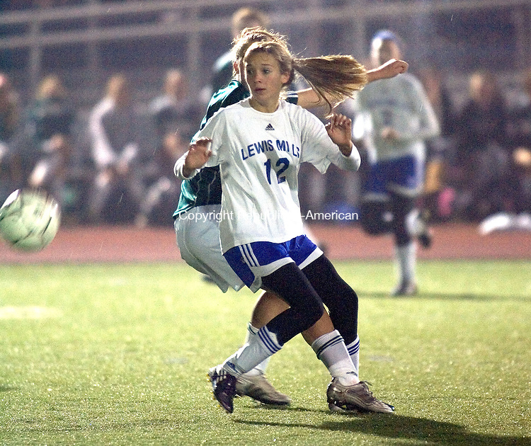 ROCKY HILL, CT. 16 November 2010-111610SV11--&nbsp;#12 Hope Sherman of Lewis Mills gets tangled with #4 Maggie Rose of Northwest Catholic during CIAC semifinal soccer action in Rocky Hill Tuesday.<br /> Steven Valenti Republican-American