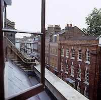 The view from the open window on the fourth floor reveals a street of 18th century town houses