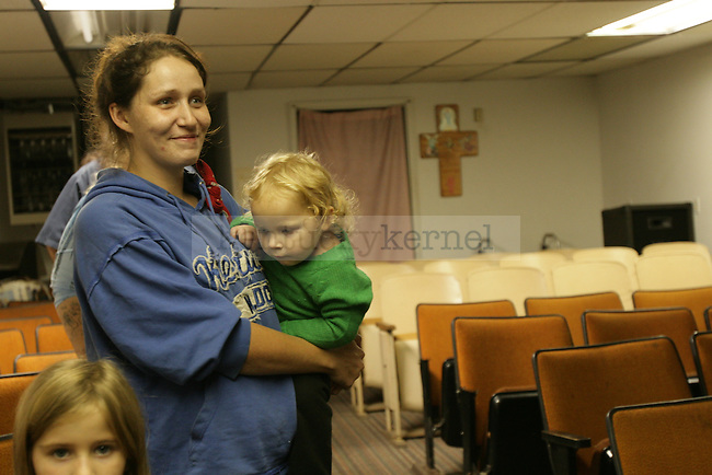 Brandy Neace holds her daughter Isabella at Bible study in Positive Faith Church in Jackson, Ky., on Wednesday, Oct. 12, 2011. She asked Pastor C.E. Boomer to pray for her mother who is in a nursing home. Photo by Becca Clemons