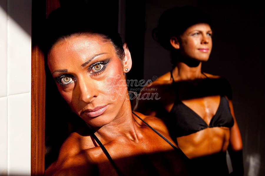 23/10/2010. Irish female physique and figure fitness national championships.  Sophia Mc Namara (1st place winner) from Limerick and Laura Newton from Galway are pictured backstage during the female physique category as part of the 2010 RIBBF national bodybuilding championships at the University of Limerick Concert Hall, Limerick, Ireland. Picture James Horan