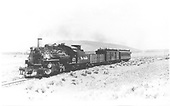 #473 K-28 with Santa Fe mixed headed south past Mount San Antonio.<br /> D&amp;RGW  Antonito area, CO