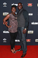 UNIVERSAL CITY, CA, USA - OCTOBER 02: Dohn Norwood, Marlene Glasper arrives at the Los Angeles Premiere Of AMC's 'The Walking Dead' Season 5 held at AMC Universal City Walk on October 2, 2014 in Universal City, California, United States. (Photo by David Acosta/Celebrity Monitor)