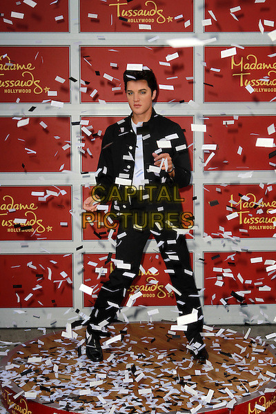 Elvis Presley Wax Figure.Madame Tussauds Hollywood Unveils First-Ever Elvis Wax Figure And Holds Fried Peanut Butter And Banana Sandwich Eating Contest Held At at Madame Tussauds Hollywood, Hollywood, California, USA..October 17th, 2012.waxwork full length black jacket trousers white top confetti .CAP/ADM/KB.©Kevan Brooks/AdMedia/Capital Pictures.