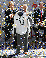 David Beckham holds his jersey at his LA Galaxy press conference at the Home Depot Center in Carson, California, Friday, July 13, 2007.